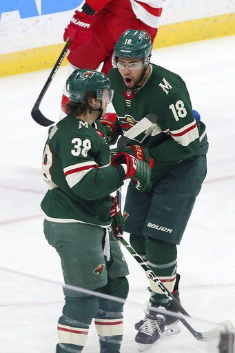 Minnesota Wild's Jordan Greenway, right, celebrates with Minnesota Wild's Ryan Hartman after scoring against Detroit Red Wings' goalie Jimmy Howard in the first period of an NHL hockey game Wednesday, Jan. 22, 2020, in St. Paul, Minn.
