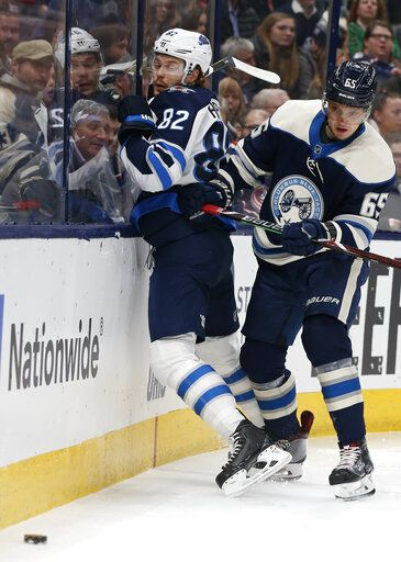 Columbus Blue Jackets' Markus Nutivaara, right, of Finland, checks Winnipeg Jets' Mason Appleton during the first period of an NHL hockey game Wednesday, Jan. 22, 2020, in Columbus, Ohio.