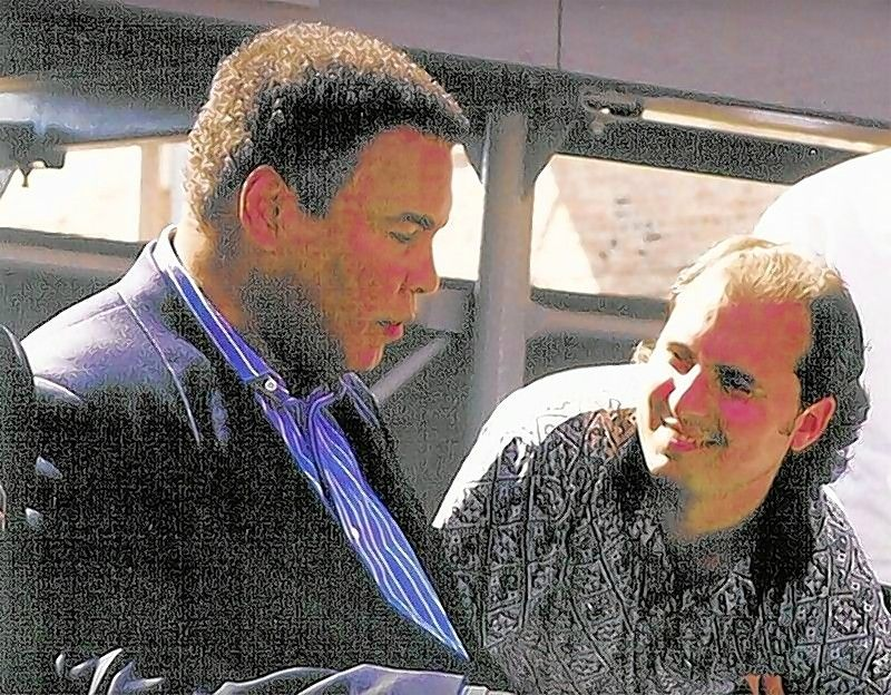 Ron Onesti with former heavyweight boxing champion Muhammad Ali in 1999 at the unveiling of a bronze statue of Rocky Marciano at the National Italian American Sports Hall of Fame Museum in Chicago.
