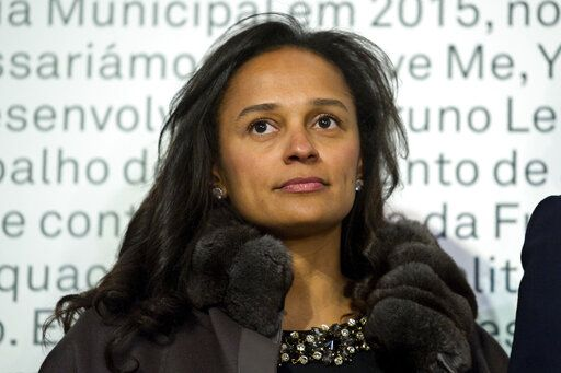 In this March 5, 2015 photo, Isabel dos Santos, reputedly Africa's richest woman, attends the opening of an art exhibition featuring works from the collection of her husband and art collector Sindika Dokolo in Porto, Portugal. On Monday, Jan. 6, 2020, Angola's foreign minister Manuel Augusto said that there is no political motivation behind the government's demand for more than $1 billion from dos Santos, her husband and a Portuguese business partner. Isabel dos Santos is a daughter of Jose Eduardo dos Santos, who ruled the oil- and diamond-rich nation for 38 years until 2017.