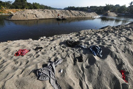 Clothing left behind by Central American migrants who camped out by the Suchiate River cover the riverbank near Ciudad Hidalgo, Mexico, Friday, Jan. 24, 2020. Mexico announced last June that it was deploying the newly formed National Guard to assist in immigration enforcement to avoid tariffs that Trump threatened on Mexican imports.
