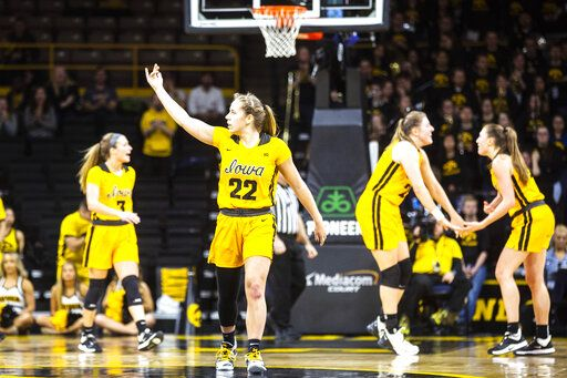 Iowa guard Kathleen Doyle (22) pumps up the crowd heading into a timeout during an NCAA college basketball game against Ohio State, Thursday, Jan. 23, 2020 in Iowa City, Iowa. (Joseph Cress/Iowa City Press-Citizen via AP)