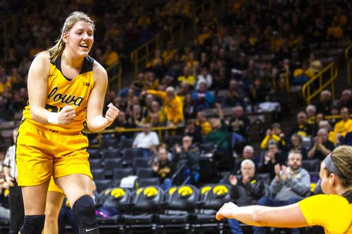 Iowa center Monika Czinano, left, cheers on teammate Makenzie Meyer after drawing a foul during an NCAA college basketball game, Thursday, Jan. 23, 2020 in Iowa City, Iowa. (Joseph Cress/Iowa City Press-Citizen via AP)