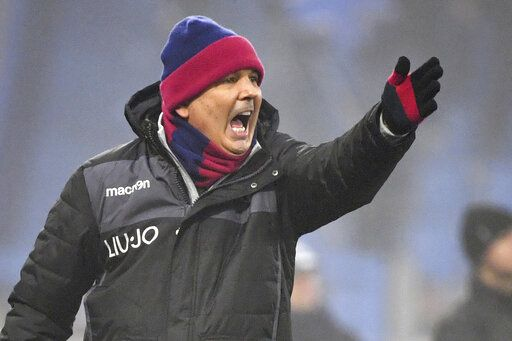 Bologna coach Sinisa Mihajlovic gestures during the Italian Serie A soccer match between Spal and Bologna at the Paolo Mazza stadium in Ferrara, Italy, Saturday, Jan. 25, 2020.  (Massimo Paolone/LaPresse via AP)