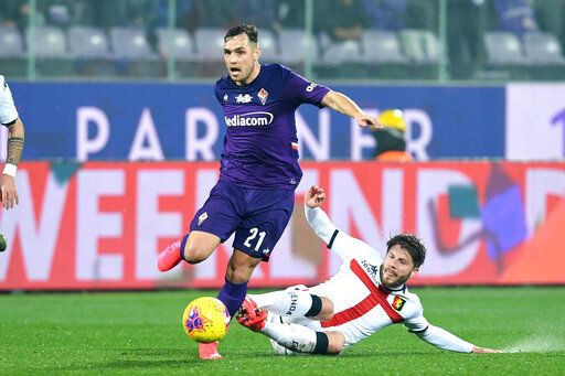Fiorentina's Pol Lirola, left, and Genoa's Lasse Schone vie for the ball during the Italian Serie A soccer match between Fiorentina and Genoa at the Artemio Franchi stadium in Florence, Italy, Saturday, Jan. 25, 2020. ( Jennifer Lorenzini /LaPresse via AP)