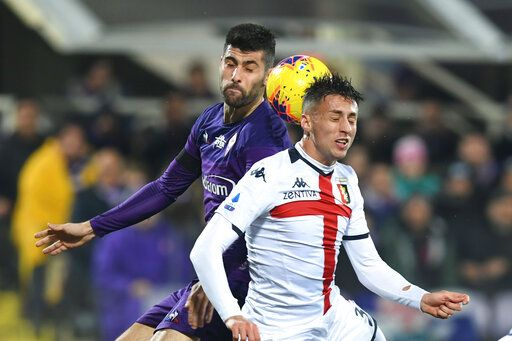 Fiorentina's Marco Benassi, left, and Genoa's Antonio Barreca vie for the ball during the Italian Serie A soccer match between Fiorentina and Genoa at the Artemio Franchi stadium in Florence, Italy, Saturday, Jan. 25, 2020. ( Jennifer Lorenzini /LaPresse via AP)