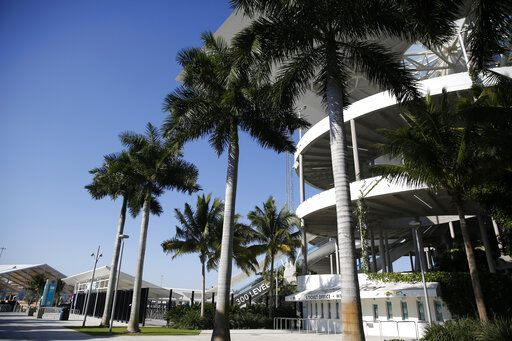 Palm trees line the outside of Hard Rock Stadium on Tuesday, Jan. 21, 2020, ahead of the NFL Super Bowl LIV football game in Miami Gardens, Fla.