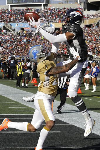 AFC wide receiver Courtland Sutton, of the Denver Broncos, (14) attempts to hold onto a pass as NFC cornerback Darius Slay, of the Detroit Lions, (23) defends, during the first half of the NFL Pro Bowl football game, Sunday, Jan. 26, 2020, in Orlando, Fla.