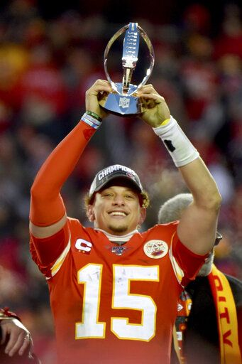 Kansas City Chiefs' Patrick Mahomes holds the Lamar Hunt Trophy after the NFL AFC Championship football game against the Tennessee Titans Sunday, Jan. 19, 2020, in Kansas City, MO. The Chiefs won 35-24 to advance to Super Bowl 54.