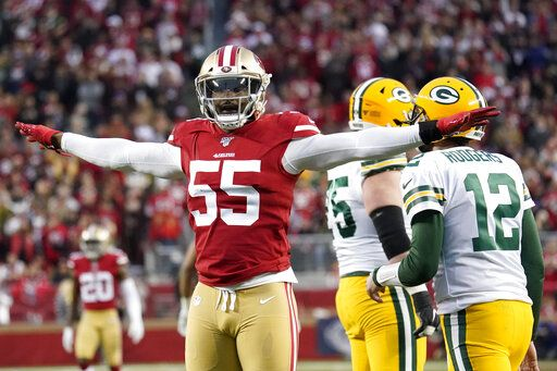 San Francisco 49ers defensive end Dee Ford (55) gestures next to Green Bay Packers quarterback Aaron Rodgers (12) during the first half of the NFL NFC Championship football game Sunday, Jan. 19, 2020, in Santa Clara, Calif.