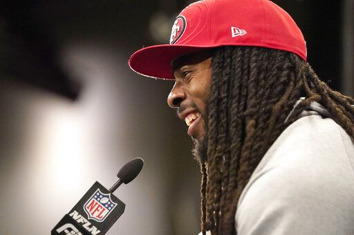 San Francisco 49ers cornerback Richard Sherman speaks to reporters after a practice at the team's NFL football training facility in Santa Clara, Calif., Friday, Jan. 24, 2020. The 49ers will face the Kansas City Chiefs in Super Bowl 54.