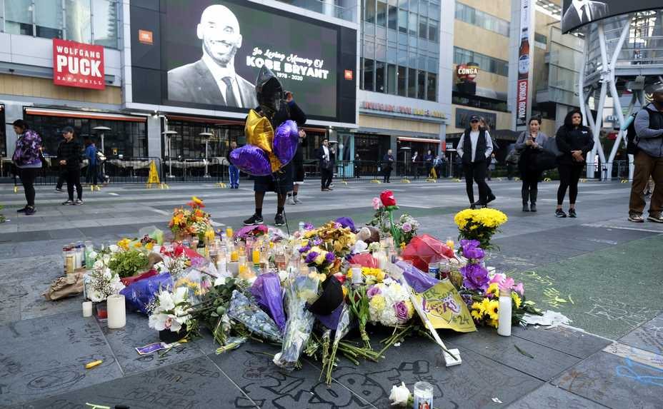 Flowers and candles are placed Monday at a memorial for Kobe Bryant near the Staples Center in Los Angeles. Bryant, the 18-time NBA All-Star who won five championships and became one of the greatest basketball players of his generation during a 20-year career with the Los Angeles Lakers, died in a helicopter crash Sunday.
