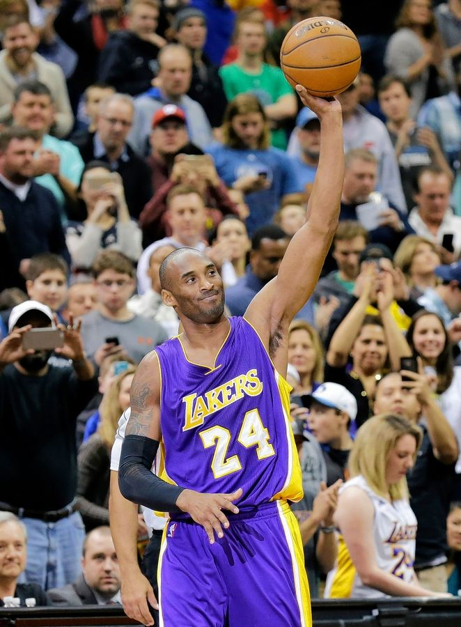 Kobe Bryant acknowledges the crowd after passing Michael Jordan on the NBA all-time scoring list in December 2014 in Minneapolis.