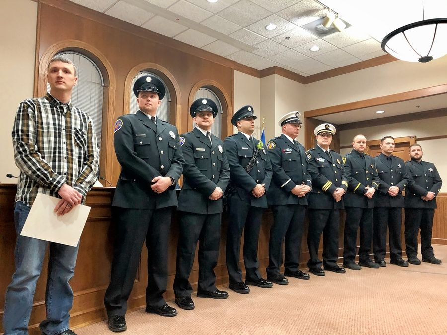 Five Barrington firefighters, three village police officers and a regional dispatcher were honored Monday night for their roles in saving the life of 4-month-old Scarlett Soeder after her mother called 911 to report her daughter didn't have a pulse and was not breathing in November. The celebration occurred at a Barrington village board meeting.