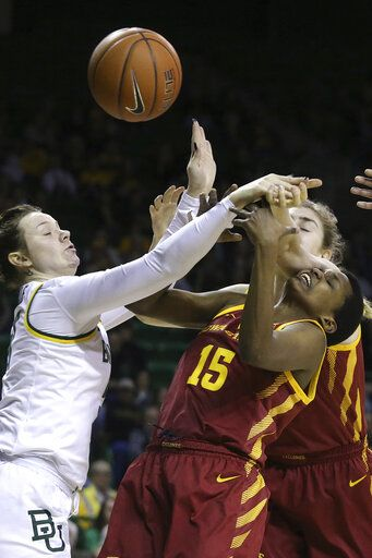 Baylor forward Caitlin Bickle (51) and Iowa State forward Inès Nezerwa (15) reach for the loose ball during the first half of an NCAA college basketball game Tuesday, Jan. 28, 2020, in Waco, Texas.