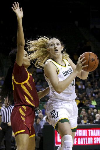 Baylor forward Lauren Cox (15) drives to the basket against Iowa State forward Kristin Scott (25) in the first half of an NCAA college basketball game Tuesday, Jan. 28, 2020, in Waco, Texas.