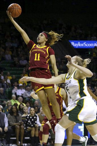 Iowa State guard Jade Thurmon (11) scores past Baylor forward Lauren Cox (15) during the first half of an NCAA college basketball game Tuesday, Jan. 28, 2020, in Waco, Texas.