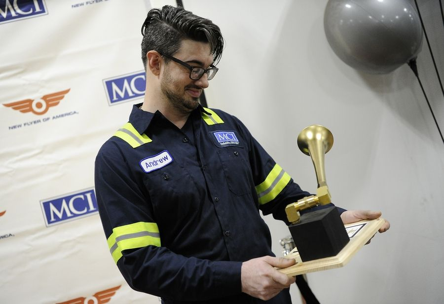 "Andrew Craig Brown's co-workers welcomed him back to the job Wednesday with a Grammy Award they created using bus parts at Motor Coach International in Des Plaines. Brown won a real Grammy in Los Angeles on Sunday for his operatic singing on composer Tobias Picker's ""Fantastic Mr. Fox."""