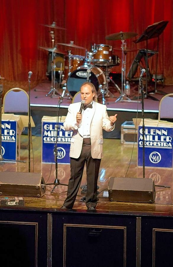 Ron Onesti talks to the audience before a performance of the Glenn Miller Orchestra at the Arcada Theatre in St. Charles.