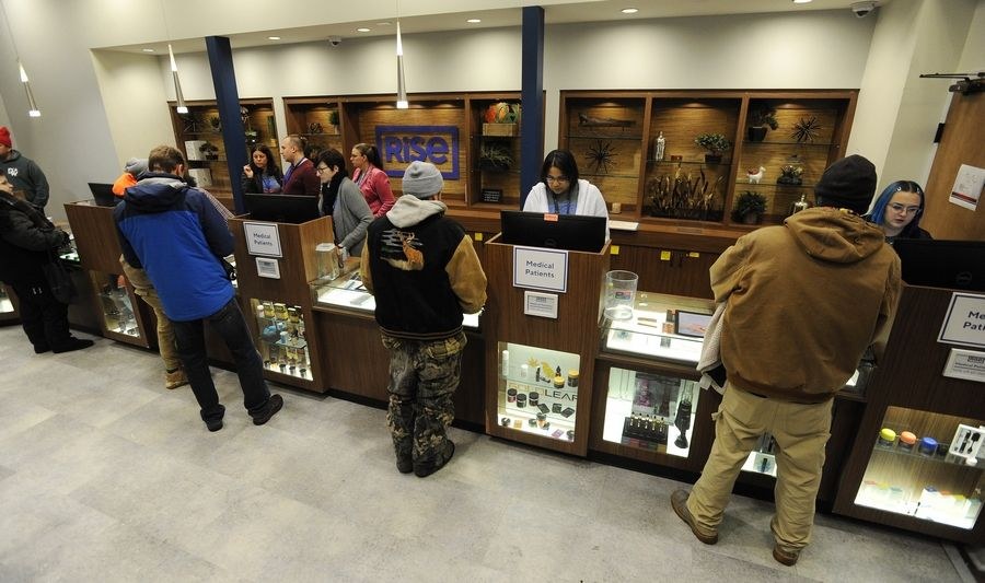 People stood in line for hours at Rise in Mundelein waiting to legally buy different forms of marijuana with about a thousand other people on New Year's Day. Patrons fill the store waiting to get their product on this New Year's Day.