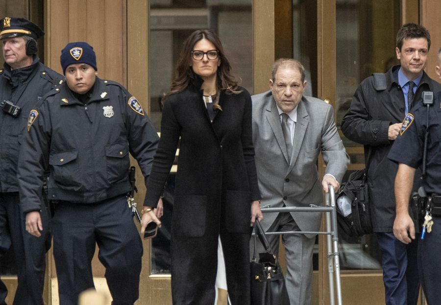 Harvey Weinstein, center, leaves court with his lead attorney Donna Rotunno, left center, at the end of the first day of jury selection in his trial Jan. 7 in New York.