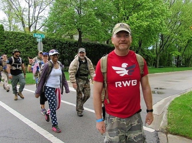 Jack Erwin, who served in the Army National Guard for 21 years, participates in the 2019 Chicago Veterans Ruck March honoring the service members who died in combat and at home. The 20-mile walk represents the 20 veterans lost daily to suicide.