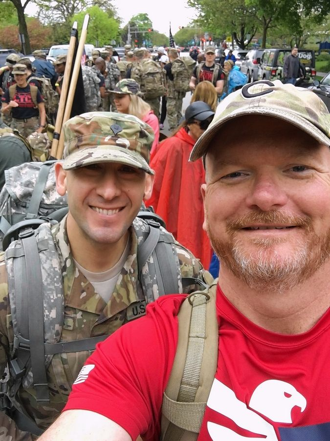 Army veteran Jack Erwin, right, poses with service member Erjon Morova before the 20-mile Chicago Veterans Ruck March last May. Erwin is a member of Team Red, White & Blue, a nonprofit that brings together veterans and active military personnel during athletic and social activities.