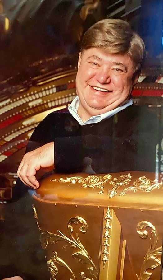 Jasper Sanfilippo sits beside the centerpiece of his vast musical instrument collection, an ornate theater organ, originally built in 1927 for the Riviera Theatre in Omaha. Once Sanfilippo acquired it, the console was designed after the original theater organ at Chicago's Paradise Theatre.