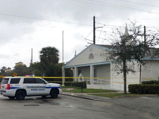 Law enforcement officials stand guard outside the Victory City Church in Riviera Beach, Fla., on Saturday, Feb. 1, 2020. Police say a fatal shooting happened after a funeral service at the church. (Hannah Morse/The Palm Beach Post via AP)