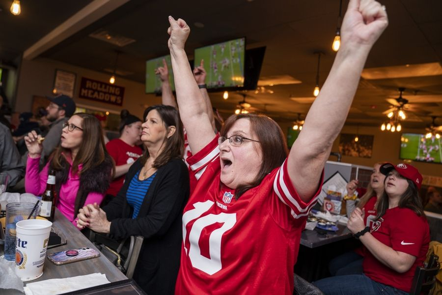 Carla Montgomery of Rolling Meadows cheers for San Francisco 49ers quarterback Jimmy Garoppolo during a Super Bowl 54 watch party to cheer on the hometown football star Sunday at Rep's Place sports bar in Rolling Meadows.
