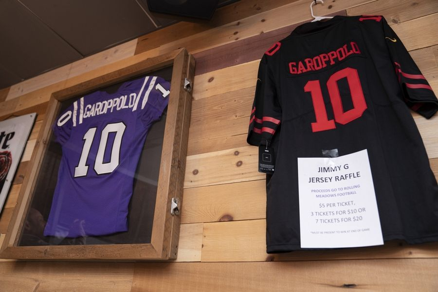 Jerseys for hometown football star Jimmy Garoppolo, quarterback for the San Francisco 49ers, hang during a Super Bowl 54 watch party Sunday evening at Rep's Place sports bar in Rolling Meadows.