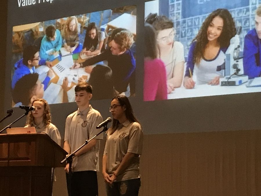 INCubatoredu students Delia Irwin, left, Matt Gallimore and Ariana Barranco explain their proposed app Linked to business leaders during a pitch event in December. Linked is geared toward young people who want to meet others with similar interests.