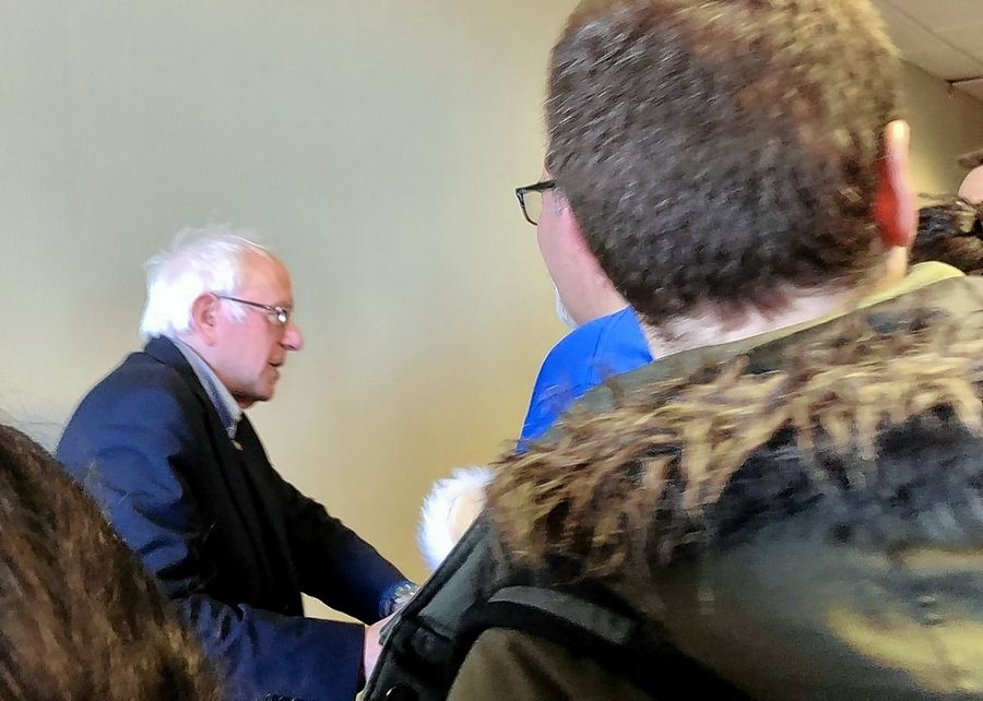 Sen. Bernie Sanders of Vermont heads to the stage Sunday at an event in Iowa City.