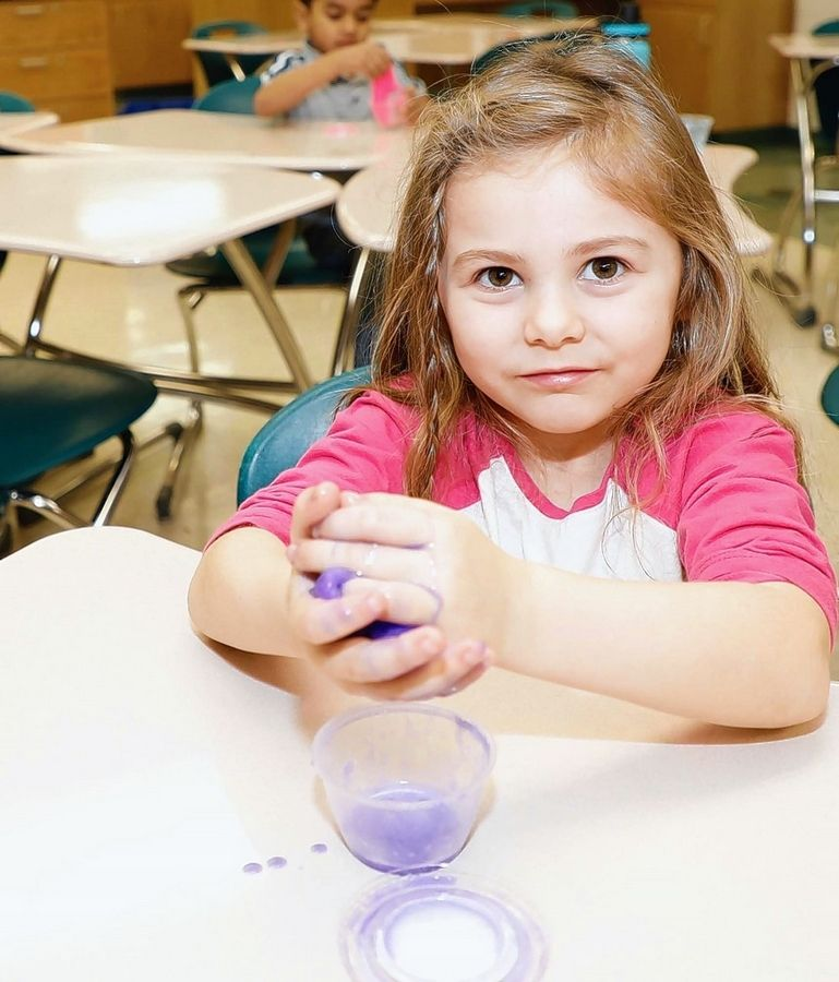 District 103 kindergartner Emma Difuccia explores a slimy substance at the Learning Fund Foundation STEAM Conference Jan. 15.