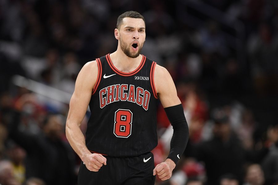 Chicago Bulls guard Zach LaVine (8) reacts after he hit a 3-point basket during the second half the team's NBA basketball game against the Washington Wizards, Wednesday, Dec. 18, 2019, in Washington. The Bulls won 110-109 in overtime.
