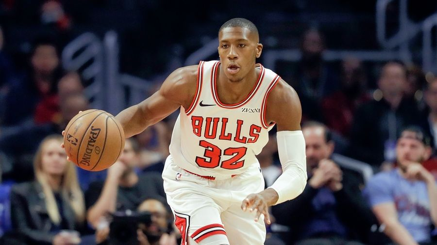 Kris Dunn will miss at least two weeks with a knee injury, the Bulls announced Tuesday.