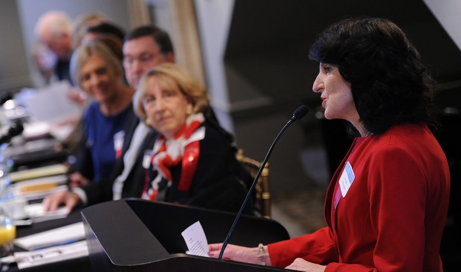 Barrington Village President Karen Darch reviews some highlights from her town during the Barrington Area Chamber of Commerce's annual Economic Summit, held Wednesday Barrington's White House.