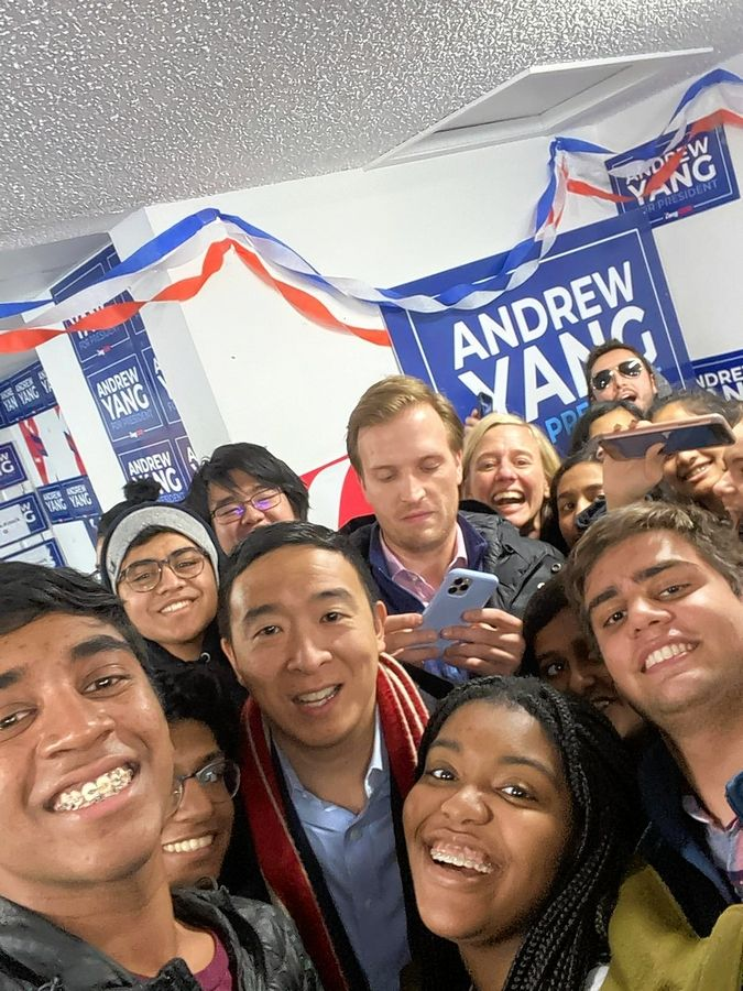 A group of civics students from Indian Prairie Unit District 204 grab a selfie with presidential candidate Andrew Yang Monday at the Iowa caucuses.