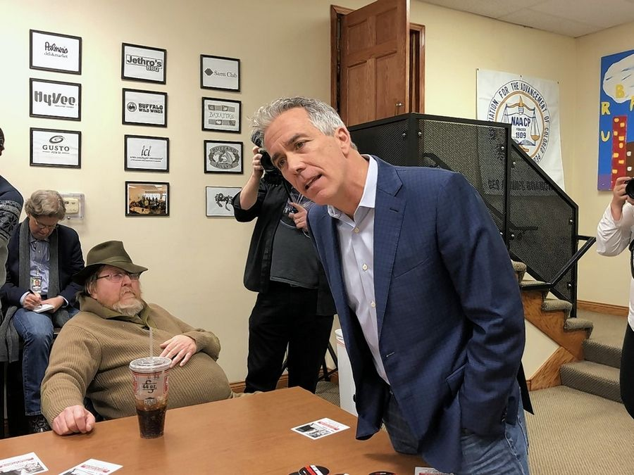 Former Rep. Joe Walsh of Mundelein makes a pitch to Iowans Jan. 31 in Des Moines as supporter James Marren, sitting, watches. He suspended his campaign against President Donald Trump Friday.