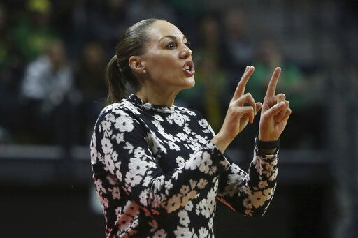 Arizona  coach Asia Barnes calls to her team during the first quarter of an NCAA college basketball game against Oregon in Eugene, Ore., Friday, Feb. 7, 2020.
