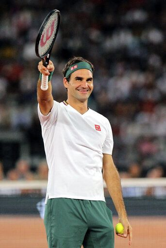 Roger Federer waves at the crowd during the exhibition tennis match against Rafael Nadal held at the Cape Town Stadium in Cape Town, South Africa, Friday Feb. 7, 2020.