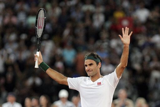 Roger Federer thanks the crowd after winning 3 sets to 2 against Rafael Nadal in their exhibition tennis match held at the Cape Town Stadium in Cape Town, South Africa, Friday Feb. 7, 2020.