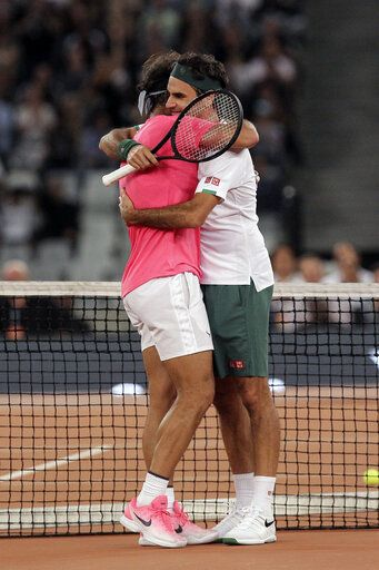 Roger Federer, right, and Rafael Nadal embrace after the final point of their exhibition tennis match held at the Cape Town Stadium in Cape Town, South Africa, Friday Feb. 7, 2020.