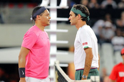 Trevor Noah and Roger Federer face off before the exhibition match held at the Cape Town Stadium in Cape Town, South Africa, Friday Feb. 7, 2020.