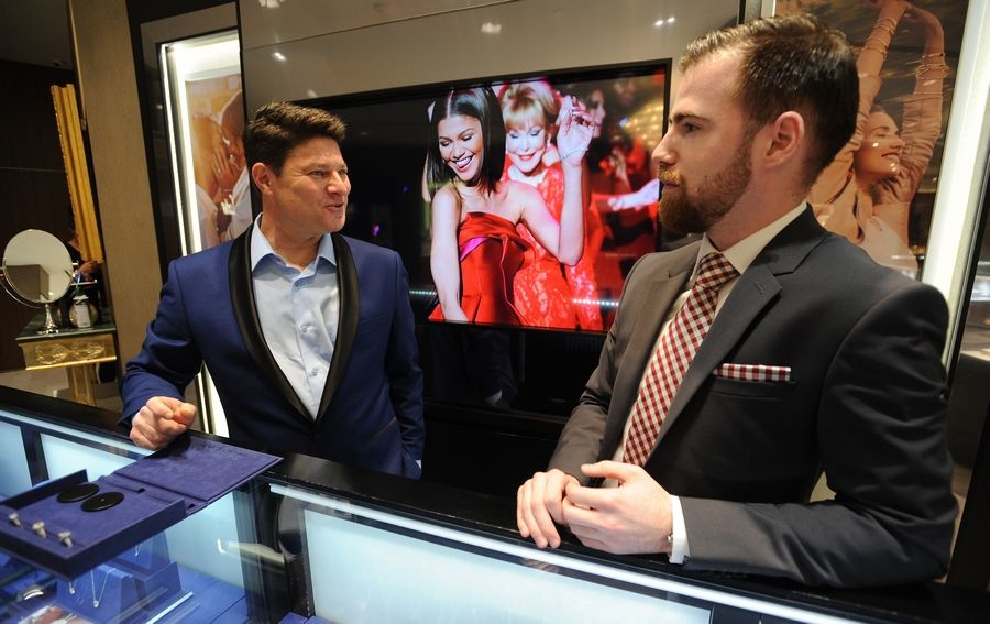 Bobby Kesselman, left, launched The Diamond Dude after he and a friend realized few men know how to shop for an engagement ring. Now Kesselman works with a variety of wedding-related business associates, such Austin Keller, right, at C.D. Peacock jewelers in Woodfield Mall in Schaumburg.