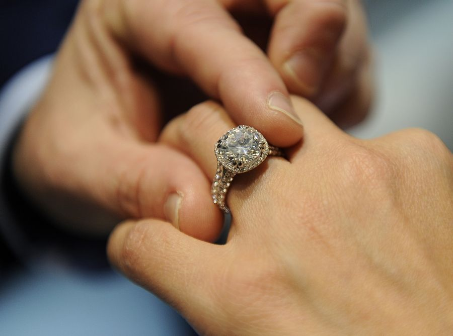 Diamonds, including gems created in labs, can be confusing for some couples shopping for engagement and wedding rings. In his new career as The Diamond Dude, Bobby Kesselman fits a ring at C.D. Peacock jewelers in Schaumburg's Woodfield Mall.