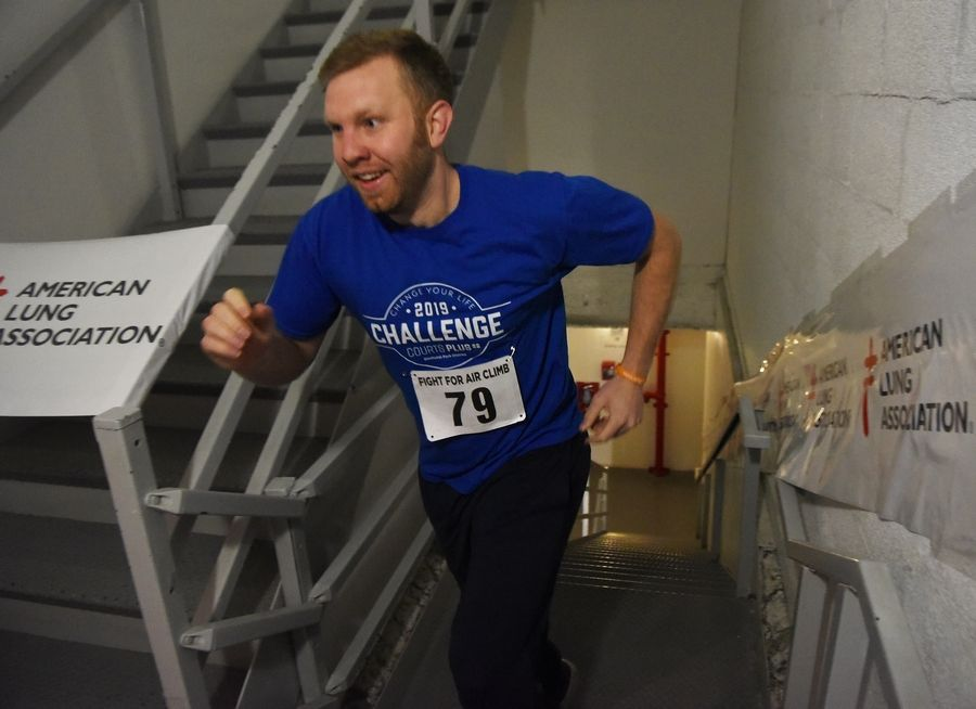 Dan Roelofs of Villa Park reaches the 31st and final flight of stairs during the American Lung Association Fight for Air Climb at the Oakbrook Terrace Tower Saturday. He was participating with the Elmhurst Park District Courts Plus team.