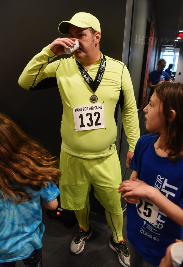 """Human Highlighter"" Jeremy Wilson of Morton Grove takes a drink after climbing 31 flights of stairs during the American Lung Association Fight for Air Climb at the Oakbrook Terrace Tower Saturday.  Wilson has worn this outfit four straight years in an effort to highlight the fight against lung disease."
