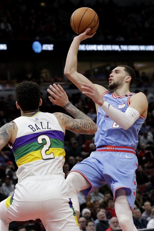 Chicago Bulls guard Zach LaVine, right, shoots against New Orleans Pelicans guard Lonzo Ball during the second half of an NBA basketball game in Chicago, Thursday, Feb. 6, 2020. The Pelicans won 125-119.