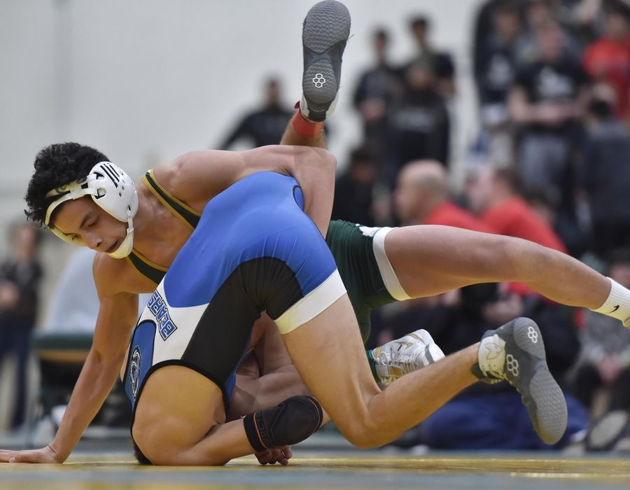 Stevenson's Cole Rhemrev controls Lake Zurich's Logan Neurauter in their 120-pound championship bout at the Stevenson High School wrestling regional meet in Lincolnshire Saturday.